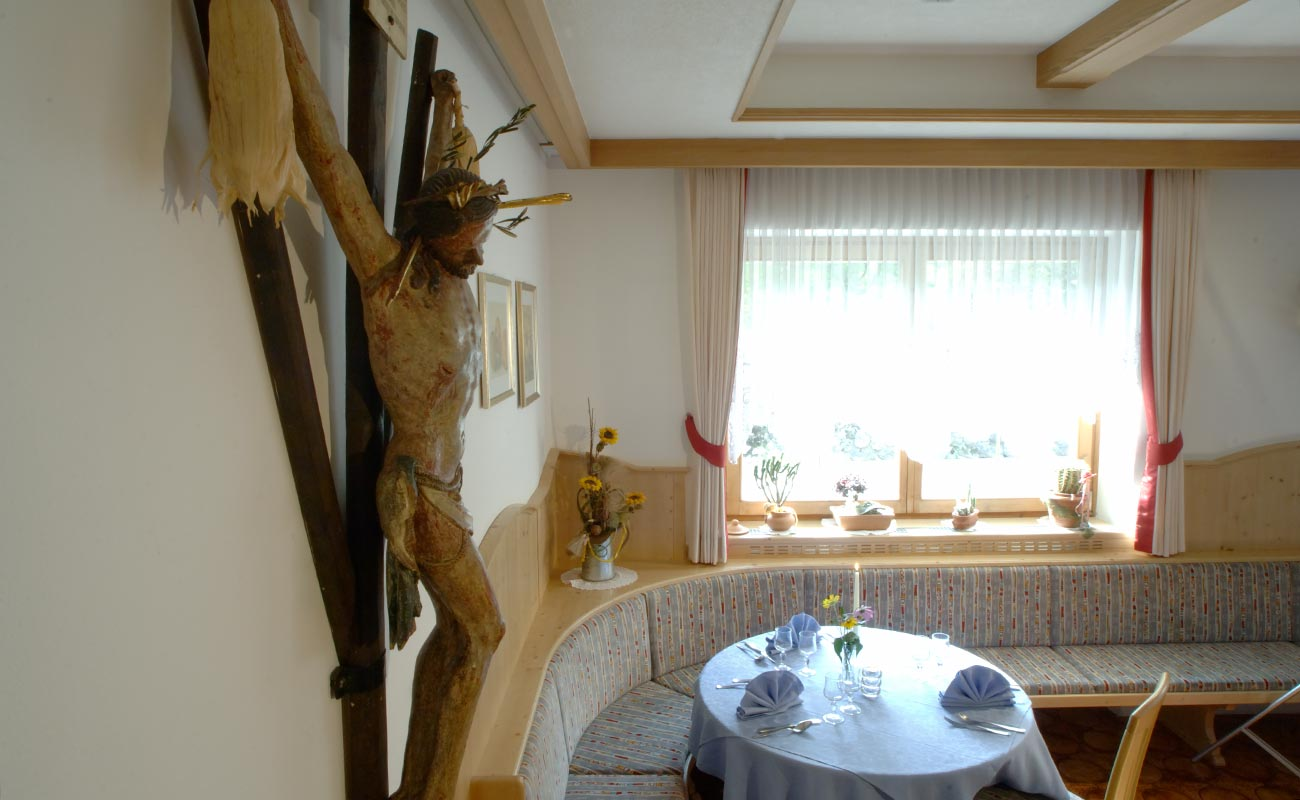 Large wooden crucifix in the dining room