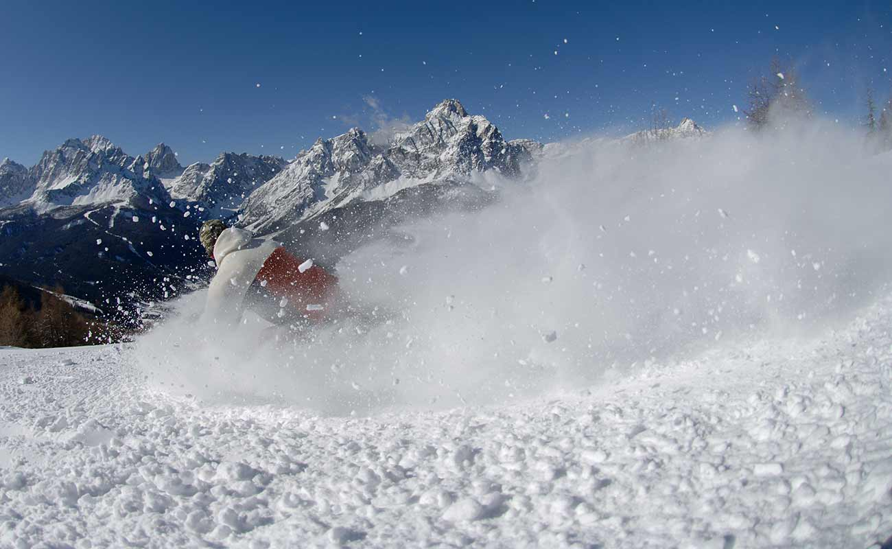 A person skis on fresh snow